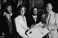 Mayor of New York City Ed Koch presenting the proclamation of Disco Week to the Bee Gees on September 1 1978