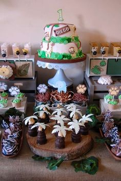 Loving this Jungle 1st Birthday Party! The cake and sweet treats are awesome!! See more party ideas and share yours at CatchMyParty.com