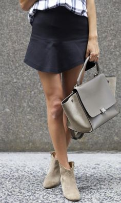 Arielle Nachmani is wearing suede shoes from Isabel Marant, skirt from Iro and a bag from Celine