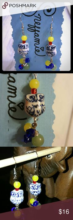 Owl dangle earrings Handcrafted earrings with blue and white ceramic owl beads.  Accent beads are acrylic and glass.  These earrings are adorable and would will bring out your playful side! Sneffamie  Jewelry Earrings