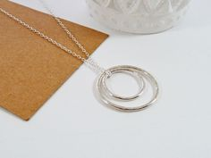 Hammered Circle Pendant, Infinity Necklace, Sterling Silver, Bridesmaid Gift, Sister Gift, BFF Gift, Contemporary, Minimal, Circle Necklace by BeauBellaJewellery on Etsy https://www.etsy.com/uk/listing/490751517/hammered-circle-pendant-infinity