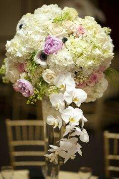 Flower delivery in Irvine by Irvine florist - White Hydrangea, Lilac, phalaenopsis, roses, anenome, with pink Peonies, arranged and placed on different elegant containers for Events. This was made for a Great Gatsby event - Great Gatsby Wedding centerpieces