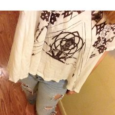 Free people top! Such an adorable top! It hands longer on the sides and has this brown pattern/design on the front! Super cute for spring! Worn less then 6 times! (Please confirm size with me because I'm not home and I'm not 100% sure of the size is a large 4/4/16) Free People Tops