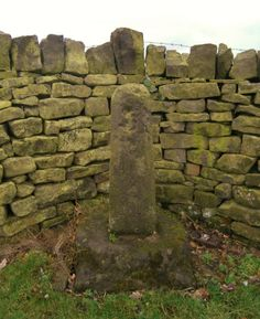 Catshaw Cross (old shaft & base) . Standing by the B6106 , in Lee Lane  Millhouse Green, 40m W of junction  with Catshaw Lane, repositioned in its original position(1980), in an alcove of the stone wall at boundary with Dunford Parish. Grid Ref SE 20617 03499 Google Earth 53.527752 -1.690463 Grade II Listed.