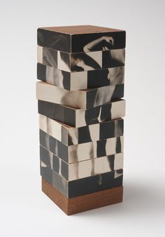 """Fractured Figure Sections"" (1967), by Robert Heinecken. Photographs, wood."