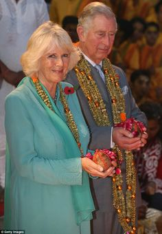 Camilla, Duchess of Cornwall and Prince Charles take part in an Aarti ceremony in India