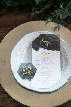 modern menu and place cards with geometric + black details - photo by Kristen Weaver Photography http://ruffledblog.com/modern-organic-wedding-inspiration-with-greenery