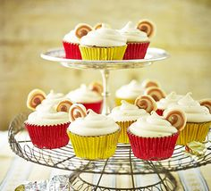 These individual sponges have a secret centre and a cream cheese frosting- serve topped with homemade caramel buttons