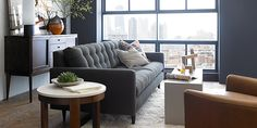 crate and barrel living room...loving the side board, sofa, chair, grey, and textures.