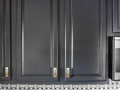 DIY: How to Refinish Cabinets Like a Pro - great tutorial shows every step it takes to get a professional finish, including how to fill holes if changing hardware & why it is SO important to number your cabinet fronts. This project cost $200 - new cabinetry would cost thousands.