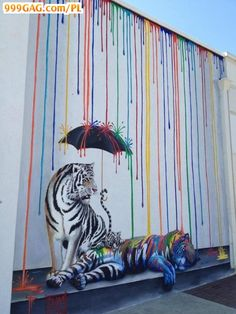 Love the colors running down (or ribbons could be added) but to me the animals should be more playful too; or no animals - just an umbrella.