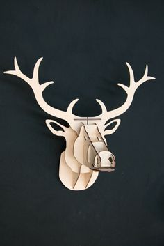 Want something unusual and original in your home? Look no further! This mdf trophy stag head is sure to make a statement in any room, whether in your city pad, rural retreat, stately home or bach. Designed and made in NZ.  The kitset trophy head comes flat packed and is simple to assemble, illustrated step-by-step instructions included. It is fixed to the wall using the two screws and template provided.  Colours: natural, black, white  Dimensions: approx 38cm wide x 39cm high
