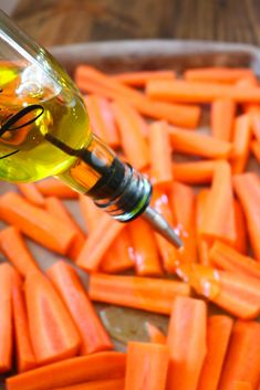Oven Roasted Carrots make a great side dish that pairs perfect with almost any main course! These cooked carrots are oven roasted with a few seasonings. Carrots In Oven, Oven Roasted Carrots, Oven Vegetables, Roasted Root Vegetables, Veggies, Roasted Vegetable Recipes, Veggie Recipes, Easy Recipes, Vegetarian Recipes