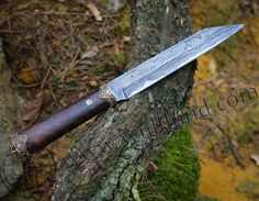 Luxury damask knife (seax type knife) with a bronze pommel and guard. Overall length: 28.5 cm, length of blade: 17.5 cm. Max. blade width: 2.6 cm, thickness of the blade: 4 mm. Made by our smithy Arma Epona.