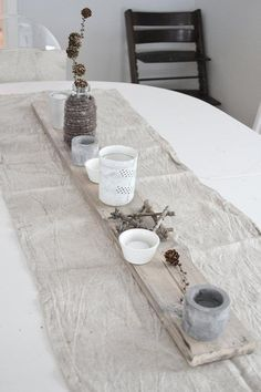 I would put pale pots of herbs down this nice board and burlap vignette.  It would meet my need for repetition in home design.  These bits of findings are sweet too.
