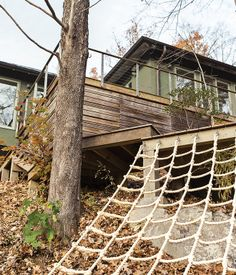 Another backyard hotspot is the deck, built around an existing boulder, where adults can lounge while the kids climb.   Photo by Eli Meir Kaplan.