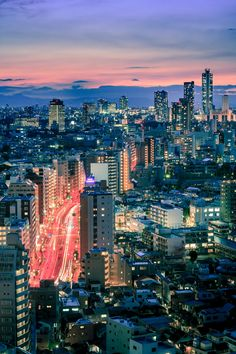 Tokyo just after sunset.  I'm usually not a fan of portrait format for those kind of photos, but the many vertical lines in this one were screaming for it ;)