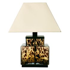 A glass faux tortoiseshell lamp with a square base. Fits an E27 bulb.