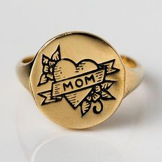 "Show mom you care. Wear this heartfelt signet ring in mom's honor, or gift it to the loving mothers in your life! A banner tattoo style engraving with ""mom"" written in the center of the heart. Mom Ring, Ring Tattoos, Tatoos, Blue Tourmaline, Signet Ring, Bridesmaid Earrings, Teardrop Earrings, Anniversary Gifts, Bridal Jewelry"