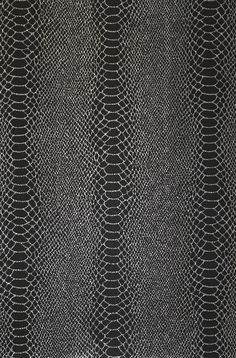 Cobra Wallpaper A faux snake skin design wallpaper in black and silver with a holigraphic finish.
