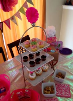 girls pink, purple, and green DIY bunting, tissue paper puffs, and cupcake table! birthday party or baby shower ideas!