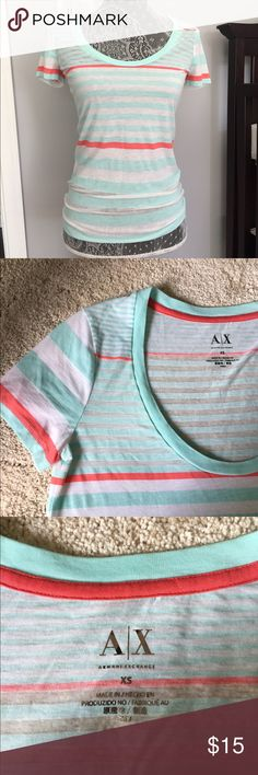 Armani exchange Tshirt Great colors in this Tshirt by A/X. Great condition. Size xs but could fit a small as well in my opinion. Slightly see thru Armani Exchange Tops Tees - Short Sleeve