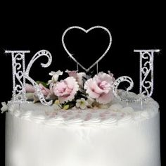 Letter cake topper.. <3 it!  But of course with C and S