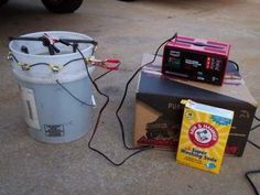 Electrolytic Parts Cleaner by kermit5327 -- Homemade electrolytic parts cleaner constructed from a plastic bucket, battery charger, electrodes, wire, washing soda, and nuts and bolts. http://www.homemadetools.net/homemade-electrolytic-parts-cleaner