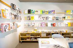 foreign correspondent: westberlin coffee shop. Plywood storage shelves...