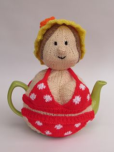 I was commissioned to design a beach babe tea cosy. Inspired by old fashioned saucy postcards featuring fat ladies; so I designed a voluptuous beach babe wearing an itsy bitsy teenie weenie red polka dot bikini. Around the back, her has managed to catch a crab when she went into the sea, or has the crab caught her? The crab hangs on and hangs freely when the tea is poured.