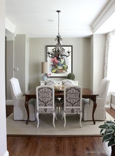 Dining room with larger upholstered host chairs
