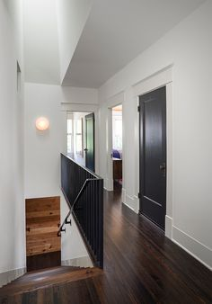 White walls and trim with black doors