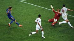 England goalkeeper Joe #Hart makes a save from Ukraine's Marko Dević to keep the score at 1-0