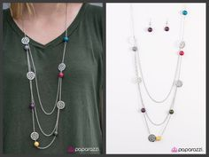 Multi-colored multi layered necklace with matching earrings. $5 Jewelry