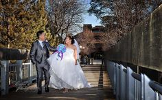 Regina Wedding Photographer -bride + groom walking on bridge