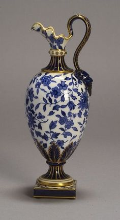Minton Porcelain Ewer |  England, c. 1900, Oenochoe shape, satyr mask handle terminal, gilt trim to underglaze floral decoration | Skinner Auctioneers