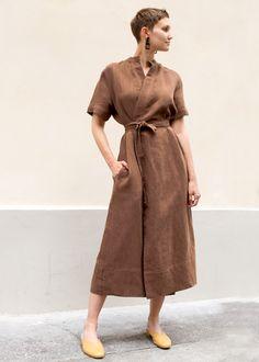 "55% Linen, 45% Cotton 51"" Length, 17"" Shoulder, 40"" Bust Dry Clean Imported"