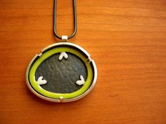 "tri-parietal framed necklace by Janice Ho enamel, copper, silver 1-1/4 x 1-3/8 x 3/16"" $250"