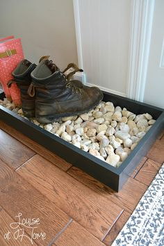DIY Boot Tray with River Rocks- Perfect this time of year with all those muddy, snow-covered boots!