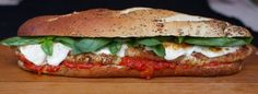 Chicken Parmesan Heroes -  the delicate baby greens of summer are replaced with panko and Parmesan-crusted chicken filets, a zesty marinara sauce, fresh basil and melted mozzarella. This 'Hero' or Italian-style submarine sandwich is messy, filling, and total comfort food. If you're looking for something a little different for Game Day, yet still appealing to the boatload of hungry guys, these Chicken Parmesan Heroes will indeed make you the hero.