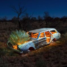 Award-winning artist Robert Fielding has been painting, illuminating, and photographing abandoned cars in the Central Australian desert.