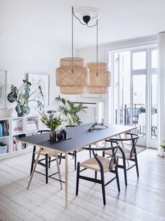 Beautiful dining room with two Ikea 'Sinnerlig' pendant lamps