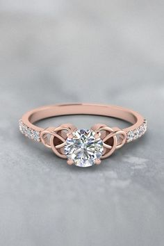 Simple Celtic Knot  Handmade Jewelry with Diamonds in 14K Rose Gold exclusively styled by Fascinating Diamonds