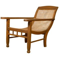 For Sale on 1stdibs - A vintage Dutch Colonial Indonesian plantation lounge chair from the mid-20th century, with rattan. Designed to provide a relaxing experience to the sitter,