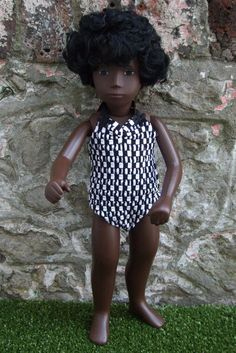 She will come dressed ready for the beach in a black and white crinkle swimsuit (just like the childrens costumes in the sixties) and has with her a black and white towel. She has her original stringing and lovely soft curly hair. | eBay!