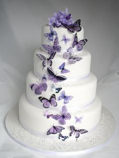 Weave in these magical and breathtaking butterfly wedding ideas on your wedding gown, reception decor, and even the cake! The butterfly teaches the magic of believing. A butterfly wedding is one of the most magical and romantic wedding themes ever. Butterfly Wedding Cake, Purple Wedding Cakes, Butterfly Cakes, Cool Wedding Cakes, Beautiful Wedding Cakes, Gorgeous Cakes, Wedding Cake Designs, Pretty Cakes, Wedding Ideas