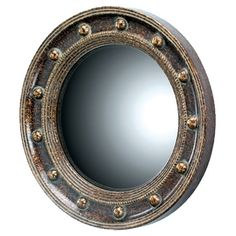 Porthole-inspired wall mirror with a weathered finish.    Product: Wall mirrorConstruction Material: Die cast res...