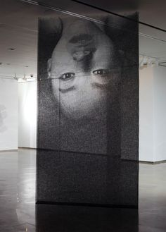Korean artist Seung Mo Park creates meticulous portraits made up of layers of mesh wire placed centimeters apart and each wire tediously cut with precision to make up an entire shadowed piece of work.