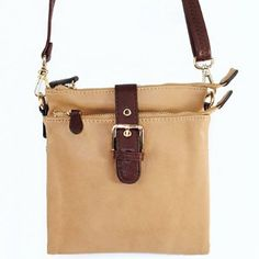 """Click here and get it at Amazon.com $28.99 Amazon.com: New Arrival """"Designer Inspired"""" Unique Buckle Embellishment Bifold Style Solid Messanger Bag / Crossbody Bag in Tan: Clothing"""
