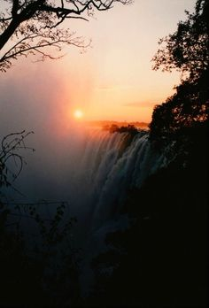 """Victoria Falls  Also called Mosi-oa-Tunya meaning """"smoke that thunders.""""  Largest waterfall based on width and height  One mile wide (1.7 km) and 360 feet high (108 meters)  Two national parks protect the falls"""